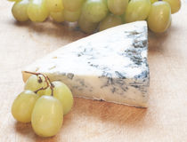 Cheese with mould and grape Stock Photos