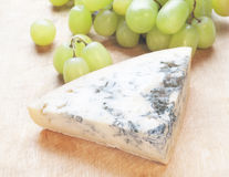 Cheese with mould and grape Royalty Free Stock Photos