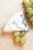 Cheese with mould and grape Royalty Free Stock Images