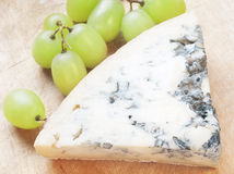 Cheese with mould and grape Stock Photography