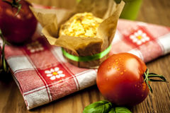 Cheese muffin. With tomato and basil on checkered napkin on wooden background Royalty Free Stock Photos