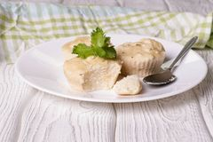 Cheese muffins with bananas. On a white plate, close up, horizontal Stock Images