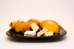 Cheese muffins on black plate with cheese Royalty Free Stock Photography
