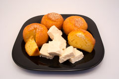 Cheese muffins on black plate with cheese Stock Images