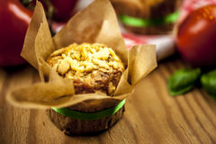 Cheese muffins. With tomato and basil on checkered napkin on wooden background Stock Images