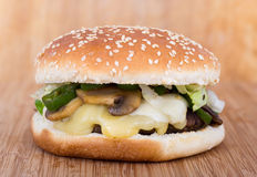 Cheese and mushroom burger. White cheese, mushroom and hot pepper burger royalty free stock image