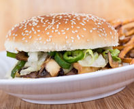 Cheese and mushroom burger. White cheese, mushroom and hot pepper burger stock images