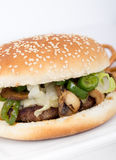 Cheese and mushroom burger. White cheese, mushroom and hot pepper burger royalty free stock photography