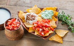 Cheese nachos with different types of sauce stock photos