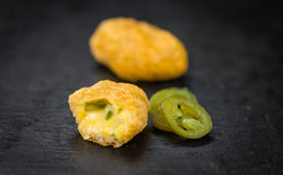 Cheese Nuggets with Chilis selective focus, close-up shot Stock Photography