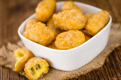 Cheese Nuggets with Chilis selective focus, close-up shot Royalty Free Stock Images