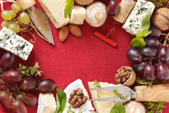 Cheese, nuts and grapes. Stock Photo