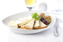 Cheese nuts and grapes fresh meal Royalty Free Stock Photo