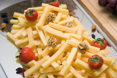 Cheese, nuts, strawberries Royalty Free Stock Image