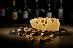 Cheese with nuts in wooden table royalty free stock photo