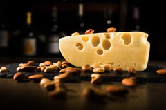 Cheese with nuts in wooden table royalty free stock images