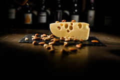 Cheese with nuts in wooden table stock photos