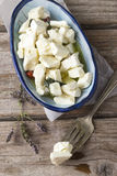 Cheese in oil Stock Photography