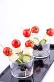Cheese and olive canapes with tomato and cucumber Royalty Free Stock Image