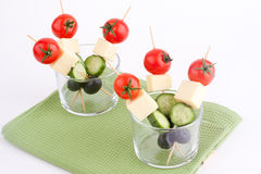 Cheese and olive canapes with tomato and cucumber Royalty Free Stock Photography