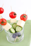 Cheese and olive canapes with tomato and cucumber Royalty Free Stock Photos