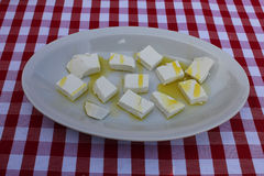 Cheese with olive oil in a dish Royalty Free Stock Photography