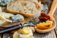 Cheese, olive oil with fresh bread closeup. Stock Photo