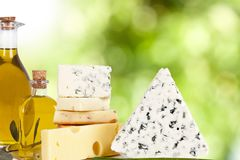 Cheese and olive oil. On natural background Stock Photo