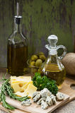 Cheese, Olive Oil, and Olives Stock Photo
