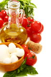 Cheese, olive oil, tomatoes and basil. Cheese, olive oil, tomatoes and basil on a white background Stock Photo