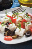 Cheese and olive salad. Feta cheese salad with rosemary, tomato and olive Stock Image