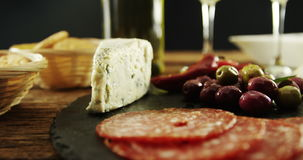 Cheese, olive and salami on table stock video