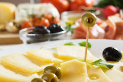 Cheese and olives Stock Photography