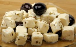 Cheese and olives Stock Images