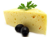 Cheese and olives. On a white background Royalty Free Stock Photo