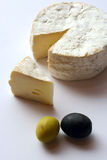Cheese and olives. Mouldy brie cheese with green and black olives Royalty Free Stock Photo