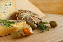 Cheese and Olives composition Royalty Free Stock Photos