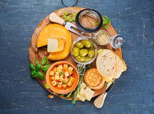 Cheese, olives and crackers Stock Photography