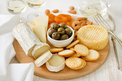 Cheese with olives, dry fruits, cookies Royalty Free Stock Image