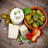 Cheese and olives Stock Photos