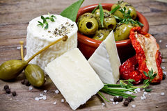Cheese and olives Royalty Free Stock Photos