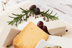 Cheese and olives. Luxurious appetizer. Royalty Free Stock Image