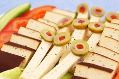 Cheese, olives and vegetables Stock Photos