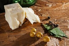 Cheese and olives on wooden surface Stock Photography