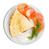 Cheese omelet  garnished with tomato Royalty Free Stock Photo
