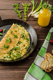 Cheese omelet with spring onions, herbs and chilli Stock Images