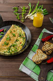 Cheese omelet with spring onions, herbs and chilli Stock Photo