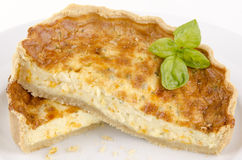 Cheese and onion quiche with basil Stock Images