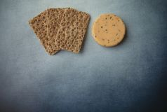 Cheese with onions,  chives and crackers. On blue background royalty free stock photos