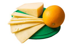 Cheese and orange. On a green chopping board cheese and an orange lie Stock Images